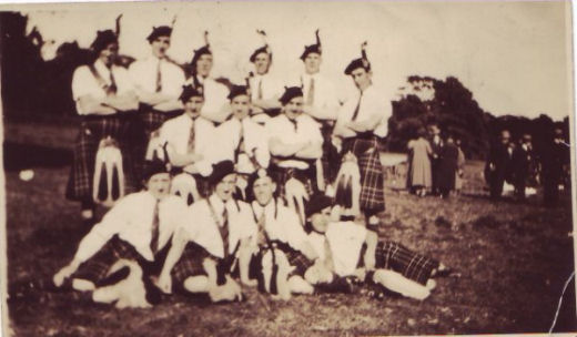 Group of Bandsmen with 1930's tartan and tassles