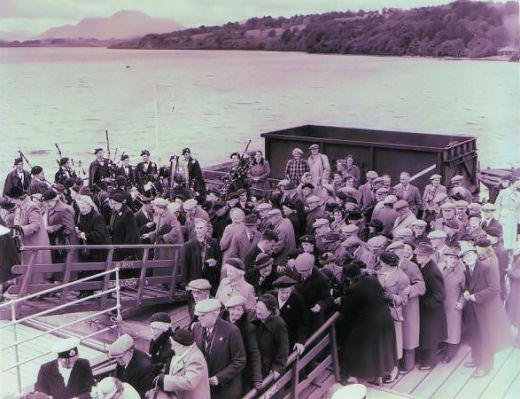 Band on Balloch pier as senior citizens outing boards the steamer.
